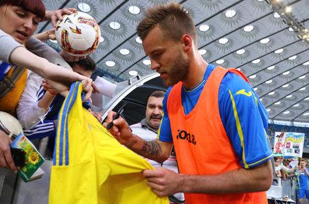 KYIV, UKRAINE - JUNE 2, 2017: Player Andriy Yarmolenko gives autograph during Open training session of Ukraine National Football Team at NSC Olimpiyskyi stadium in Kyiv, Ukraine