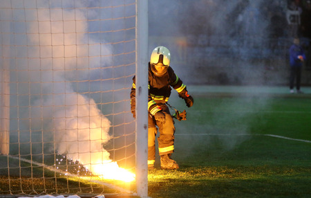 MARIBOR, SLOVENIA - NOVEMBER 17, 2015: Firefighter in action during UEFA EURO 2016 Play-off for Final Tournament game between Slovenia and Ukraine at Stadion Ljudski vrt in Maribor, Slovenia Editorial