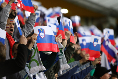 MARIBOR, SLOVENIA - NOVEMBER 17, 2015: Slovenian supporters show their support during UEFA EURO 2016 Play-off for Final Tournament game Slovenia v Ukraine at Stadion Ljudski vrt in Maribor, Slovenia