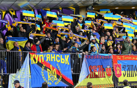 MARIBOR, SLOVENIA - NOVEMBER 17, 2015: Ukrainian supporters show their support during UEFA EURO 2016 Play-off for Final Tournament game Slovenia v Ukraine at Stadion Ljudski vrt in Maribor, Slovenia Editorial