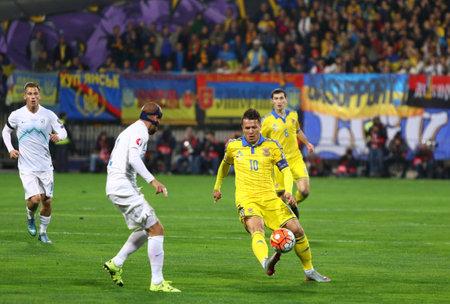 MARIBOR, SLOVENIA - NOVEMBER 17, 2015: Yevhen Konoplyanka of Ukraine (R) fights for a ball with Miso Brecko of Slovenia during their UEFA EURO 2016 Play-off game at Stadion Ljudski vrt in Maribor