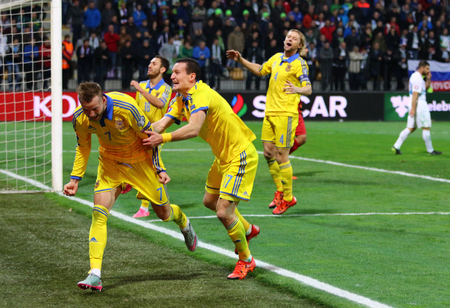 scored: MARIBOR, SLOVENIA - NOVEMBER 17, 2015: Ukrainian footballers react after scored a goal during UEFA EURO 2016 Play-off for Final Tournament game against Slovenia at Stadion Ljudski vrt in Maribor Editorial