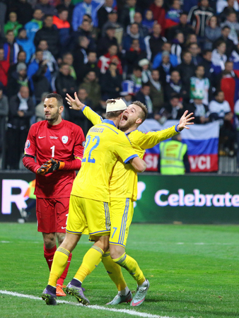 MARIBOR, SLOVENIA - NOVEMBER 17, 2015: Ukrainian footballers react after scored a goal during UEFA EURO 2016 Play-off for Final Tournament game against Slovenia at Stadion Ljudski vrt in Maribor Editorial