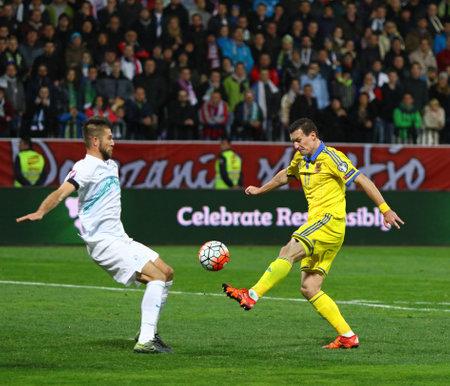 MARIBOR, SLOVENIA - NOVEMBER 17, 2015: Artem Fedetskiy of Ukraine (R) fights for a ball with Bojan Jokic of Slovenia during their UEFA EURO 2016 Play-off game at Stadion Ljudski vrt in Maribor