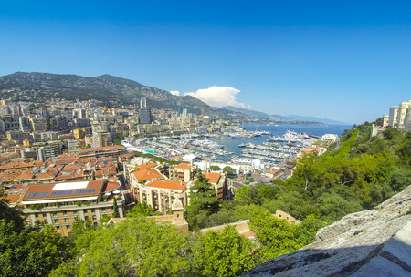 Panoramic view of Monte Carlo city. Luxury yachts and apartments in harbor of Monte Carlo, Cote dAzur, Principality of Monaco