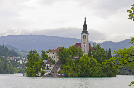saint martin: Landscape with Saint Martin church on the island on Bled lake, Bled, Slovenia. Julian Apls on the background