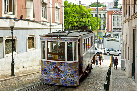 LISBON, PORTUGAL - JUNE 11, 2013: The Gloria Funicular (Ascensor da Gloria), funicular railway line in Lisbon. Connects Pombaline downtown with the Bairro Alto. Carriage decorated with Azulejos tiles