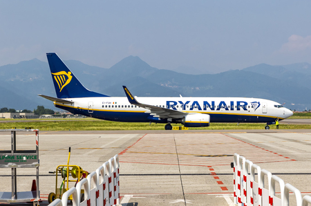 reg: BERGAMO, ITALY - JUNE 12, 2017: Boeing 737-8AS (reg. number EI-FON), operated by RyanAir on the runway of Bergamo Orio al Serio Airport (BGY). Ryanair is an Irish low-cost airline founded in 1984