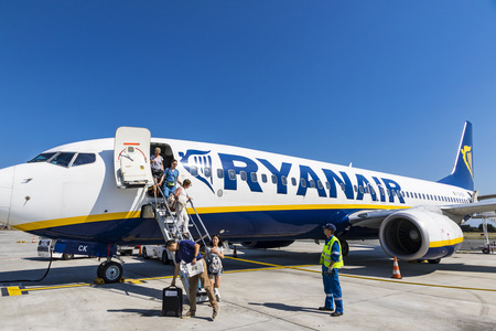 reg: BORDEAUX, FRANCE - JUNE 12, 2017: Passengers disembarking from a Boeing 737-8AS (reg. number EI-DCK), operated by RyanAir in Bordeaux-Merignac Airport (BOD). Ryanair is an Irish low-cost airline