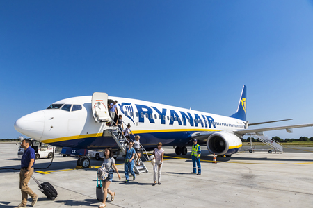 BORDEAUX, FRANCE - JUNE 12, 2017: Passengers disembarking from a Boeing 737-8AS (reg. number EI-DCK), operated by RyanAir in Bordeaux-Merignac Airport (BOD). Ryanair is an Irish low-cost airline