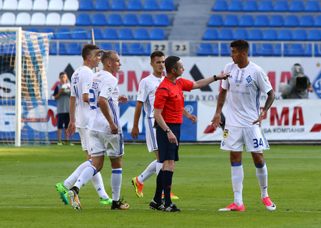 KYIV, UKRAINE - JULY 18, 2017: Referee Yuriy Hrysio talks to FC Dynamo Kyiv players during their Ukrainian Premier League against FC Chornomorets Odesa at Valeriy Lobanovskyi stadium in Kyiv, Ukraine