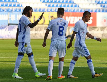 KYIV, UKRAINE - JULY 18, 2017: FC Dynamo Kyiv players celebrate a goal during Ukrainian Premier League game against FC Chornomorets Odesa at Valeriy Lobanovskyi stadium in Kyiv, Ukraine
