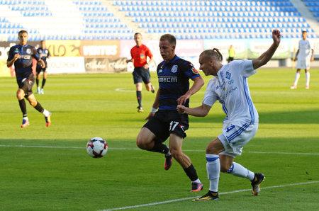 KYIV, UKRAINE - JULY 18, 2017: Domagoj Vida of FC Dynamo Kyiv (R) fights for a ball with Mykyta Tatarkov of Chornomorets Odesa during their Ukrainian Premier League game at Valeriy Lobanovskyi stadium