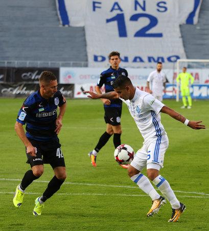 KYIV, UKRAINE - JULY 18, 2017: Derlis Gonzalez of FC Dynamo Kyiv (R) fights for a ball with Yevhen Zubeyko of Chornomorets Odesa during their Ukrainian Premier League game at V.Lobanovskyi stadium