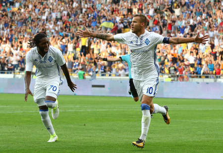 scored: KYIV, UKRAINE - JULY 26, 2017: FC Dynamo Kyiv players celebrate after scored a goal during UEFA Champions League 3rd qualifying round game against Young Boys at NSC Olimpiyskyi stadium in Kyiv Editorial