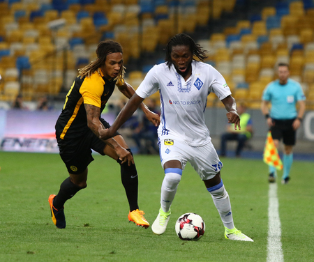KYIV, UKRAINE - JULY 26, 2017: Dieumerci Mbokani of Dynamo Kyiv (R) fights for a ball with Kevin Mbabu of Young Boys during their UEFA Champions League 3rd qualifying round game in Kyiv, Ukraine