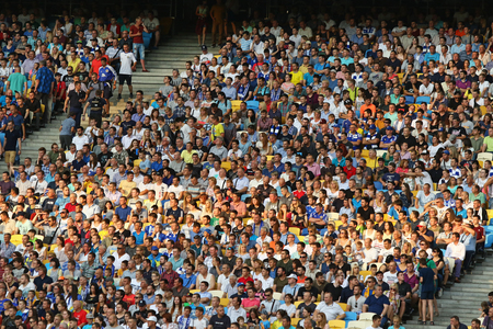 KYIV, UKRAINE - JULY 26, 2017: Crowded tribunes of NSC Olimpiyskyi stadium in Kyiv during UEFA Champions League 3rd qualifying round game between FC Dynamo Kyiv and Young Boys