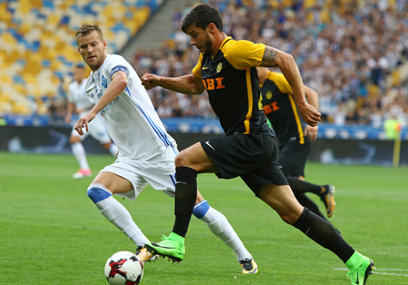 KYIV, UKRAINE - JULY 26, 2017: Andriy Yarmolenko of Dynamo Kyiv (L) fights for a ball with Loris Benito of Young Boys during their UEFA Champions League 3rd qualifying round game Editorial