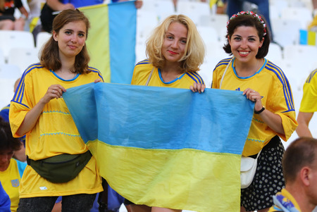 MARSEILLE, FRANCE - JUNE 21, 2016: Ukrainian fans show their support during the UEFA EURO 2016 game Ukraine v Poland at Stade Velodrome in Marseille, France Editorial