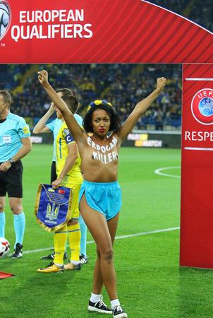 KHARKIV, UKRAINE - SEPTEMBER 2, 2017: Femen activist invades on the pitch with the inscription