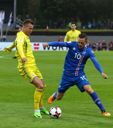 REYKJAVIK, ICELAND - SEPTEMBER 5, 2017: Gylfi Sigurdsson of Iceland (R) fights for a ball with Andriy Yarmolenko of Ukraine during their FIFA World Cup 2018 qualifying game at Laugardalsvollur stadium