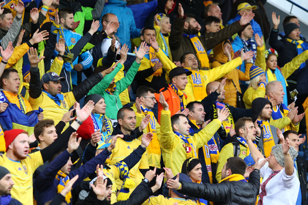 REYKJAVIK, ICELAND - SEPTEMBER 5, 2017: Ukraine National Team supporters show their support during FIFA World Cup 2018 qualifying game Iceland v Ukraine at Laugardalsvollur stadium in Reykjavik