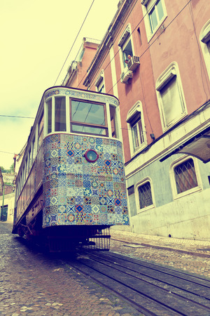 Gloria Funicular (Ascensor da Gloria), is a funicular railway line in Lisbon, Portugal. Connects the Pombaline downtown with the Bairro Alto. Carriage decorated with famous Azulejos tiles. Ink filter