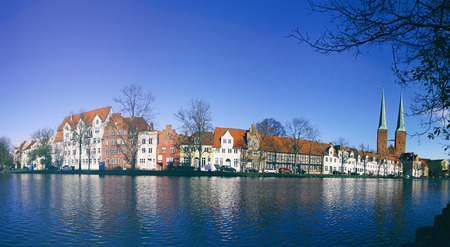 Panoramic skyline of the medieval city of Lubeck, Germany. Colour cast filter Stock Photo