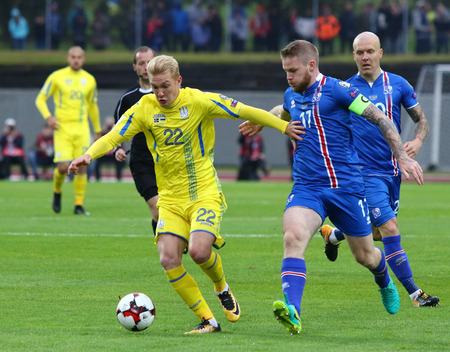 REYKJAVIK, ICELAND - SEPTEMBER 5, 2017: Aron Gunnarsson of Iceland (R) fights for a ball with Viktor Kovalenko of Ukraine during their FIFA World Cup 2018 qualifying game in Reykjavik, Iceland