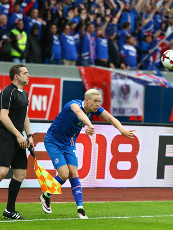 REYKJAVIK, ICELAND - SEPTEMBER 5, 2017: Hordur Magnusson of Iceland throws in the ball during FIFA World Cup 2018 qualifying game against Ukraine at Laugardalsvollur stadium in Reykjavik, Iceland