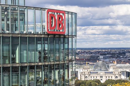 BERLIN, GERMANY - SEPTEMBER 22, 2017: DB Logo on the top of Bahn Tower. Its a 26-story, 103m skyscraper on Potsdamer Platz in Berlin, Germany. Office space for the German Railway (Deutsche Bahn) HQ