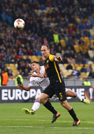 KYIV, UKRAINE - OCTOBER 26, 2017: Junior Moraes of Dynamo Kyiv (in White) fights for a ball with Steve von Bergen of Young Boys during their UEFA Europa League game at NSC Olimpiyskyi stadium in Kyiv