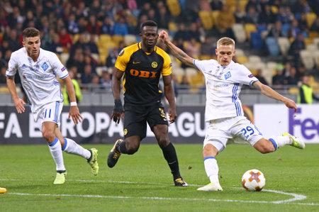 KYIV, UKRAINE - OCTOBER 26, 2017: Vitaliy Buyalskiy of Dynamo Kyiv (R) kicks a ball during UEFA Europa League game against Young Boys at NSC Olimpiyskyi stadium in Kyiv, Ukraine