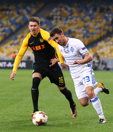 KYIV, UKRAINE - OCTOBER 26, 2017: Tomasz Kedziora of Dynamo Kyiv (R) fights for a ball with Christian Fassnacht of Young Boys during their UEFA Europa League game at NSC Olimpiyskyi stadium in Kyiv