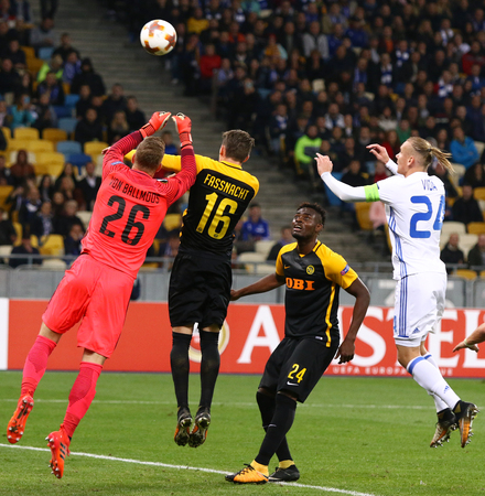 KYIV, UKRAINE - OCTOBER 26, 2017: Domagoj Vida of Dynamo Kyiv (White) fights for a ball with Young Boys players ang goalkeeper during their UEFA Europa League game at NSC Olimpiyskyi stadium in Kyiv