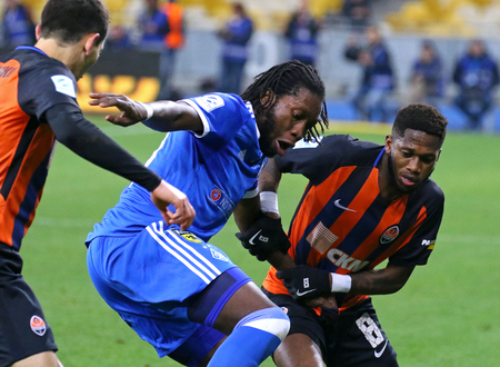 KYIV, UKRAINE - OCTOBER 22, 2017: Dieumerci Mbokani of FC Dynamo Kyiv (in Blue) fights for a ball with Fred of FC Shakhtar Donetsk during their Ukrainian Premier League game at NSC Olympic stadium
