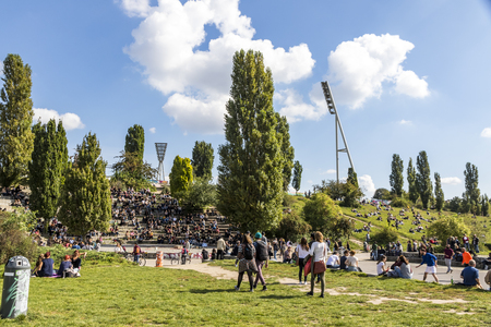 "BERLIN, GERMANY - SEPTEMBER 17, 2017: People enjoy sunny Sunday at Mauerpark. Situated in ""death strip"" of Berlin Wall (Mauer) Mauerpark is now a social, cultural and artistic center of Berlin Editorial"