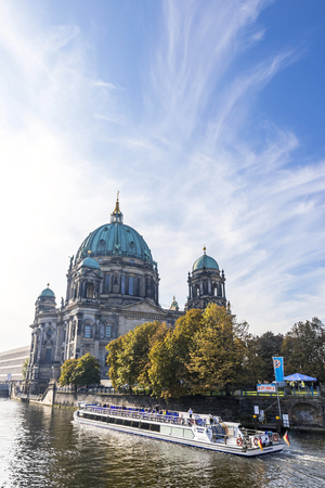 BERLIN, GERMANY - SEPTEMBER 17, 2017: Tourist boat on Spree river near Museum island (Museumsinsel) in Berlin. Berlin Cathedral (Berliner Dom) on the background. Editorial
