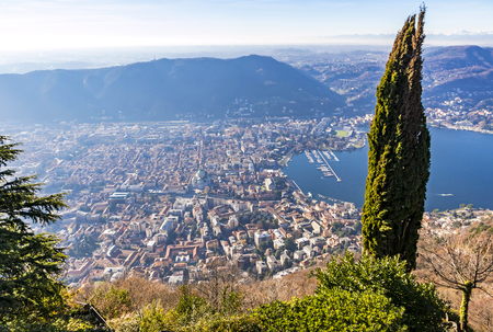 Aerial landscape of the picturesque colorful City of Como on Lake Como, Italy. European Alps on the background. European vacation, living life style, architecture and travel concept Stock Photo