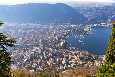Aerial landscape of the picturesque colorful City of Como on Lake Como, Italy. European Alps on the background