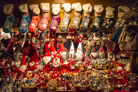 COMO, ITALY - DECEMBER 2, 2016: Kiosks stall with handmade Christmas gifts in annual traditional Christmas fair on Piazza Cavour in center of Como old town, Lombardy, Italy