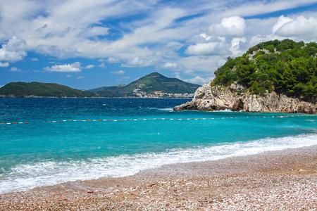 Picturesque summer view of Adriatic seacoast in Budva Riviera. Milocer beach (Milocer plaza), Sveti Stefan, Montenegro