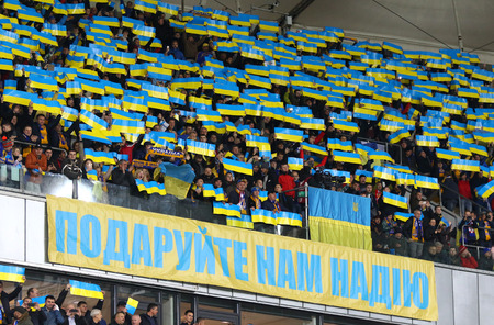 KYIV, UKRAINE - OCTOBER 9, 2017: Ukrainian supporters show their support during the FIFA World Cup 2018 qualifying game against Croatia at NSC Olimpiyskyi stadium in Kyiv, Ukraine Editorial