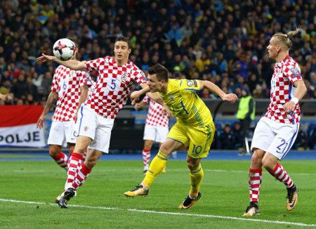 KYIV, UKRAINE - OCTOBER 9, 2017: Yevhen Konoplyanka of Ukraine (in Yellow) kicks a ball during FIFA World Cup 2018 qualifying game against Croatia at NSC Olimpiyskyi stadium in Kyiv, Ukraine