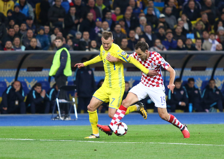KYIV, UKRAINE - OCTOBER 9, 2017: Andriy Yarmolenko of Ukraine (L) fights for a ball with Milan Badelj of Croatia during their FIFA World Cup 2018 qualifying game at NSC Olimpiyskyi stadium in Kyiv