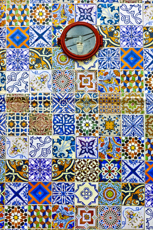 Famous Azulejos tiles on the carriage of The Gloria Funicular (Portuguese: Ascensor da Gloria), funicular railway line in Lisbon, Portugal. It connects the Pombaline downtown with the Bairro Alto Stock Photo
