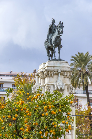 Monument to the Fernando III El Santo (Ferdinand III the Saint, King of Castile) on Plaza Nueva in Seville city, Andalusia, Spain