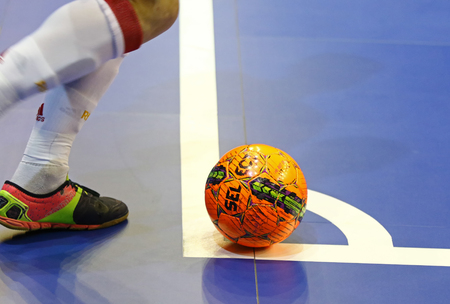 KYIV, UKRAINE - JANUARY 29, 2017: Orange Futsal ball at the corner mark during friendly Futsal match Ukraine v Spain at Palats of Sports in Kyiv, Ukraine