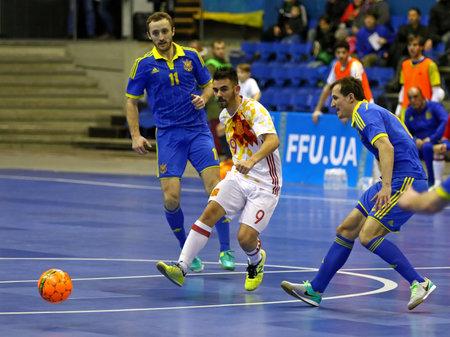 KYIV, UKRAINE - JANUARY 29, 2017: Alex Yepes of Spain (in White) kicks the ball during friendly Futsal match against Ukraine at Palats of Sports in Kyiv, Ukraine