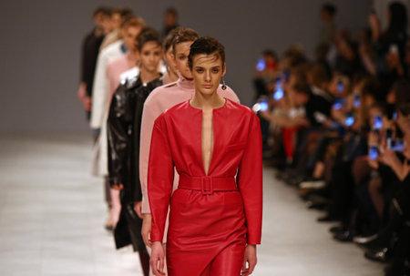 KYIV, UKRAINE - FEBRUARY 3, 2018: Models present a creation by designer Elena BURENINA during 42nd Ukrainian Fashion Week season Fall/Winter 2018/19 at Mystetskyi Arsenal in Kyiv, Ukraine Éditoriale